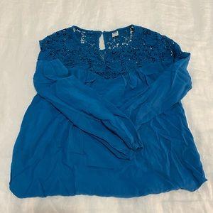 Flowy blue blouse with lace neckline